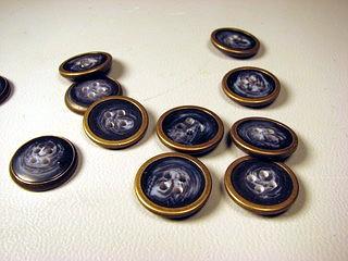 brass rimmed buttons